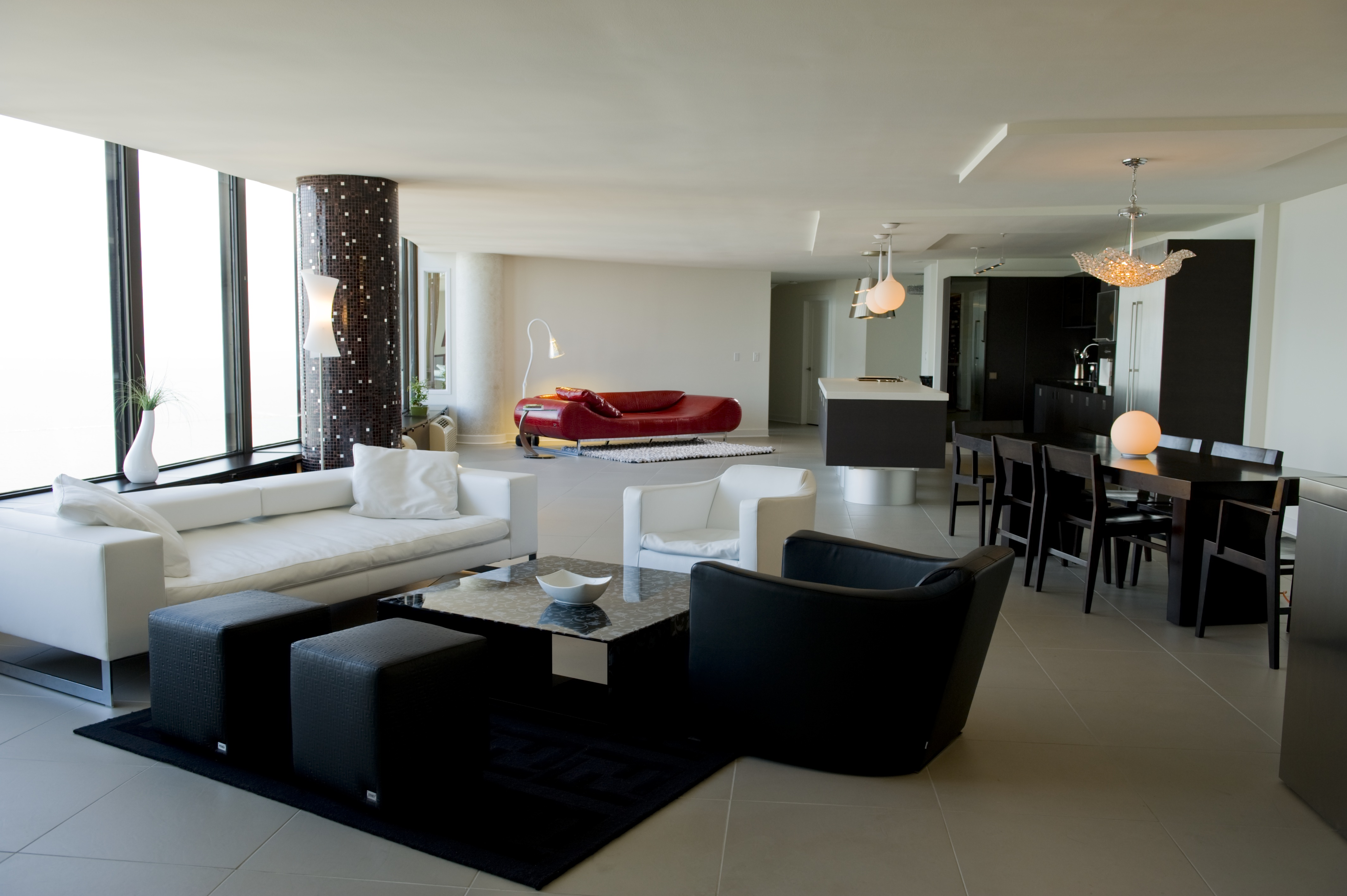 Two condo units were combined to create a large home. Fendi furniture is from Haute Living.