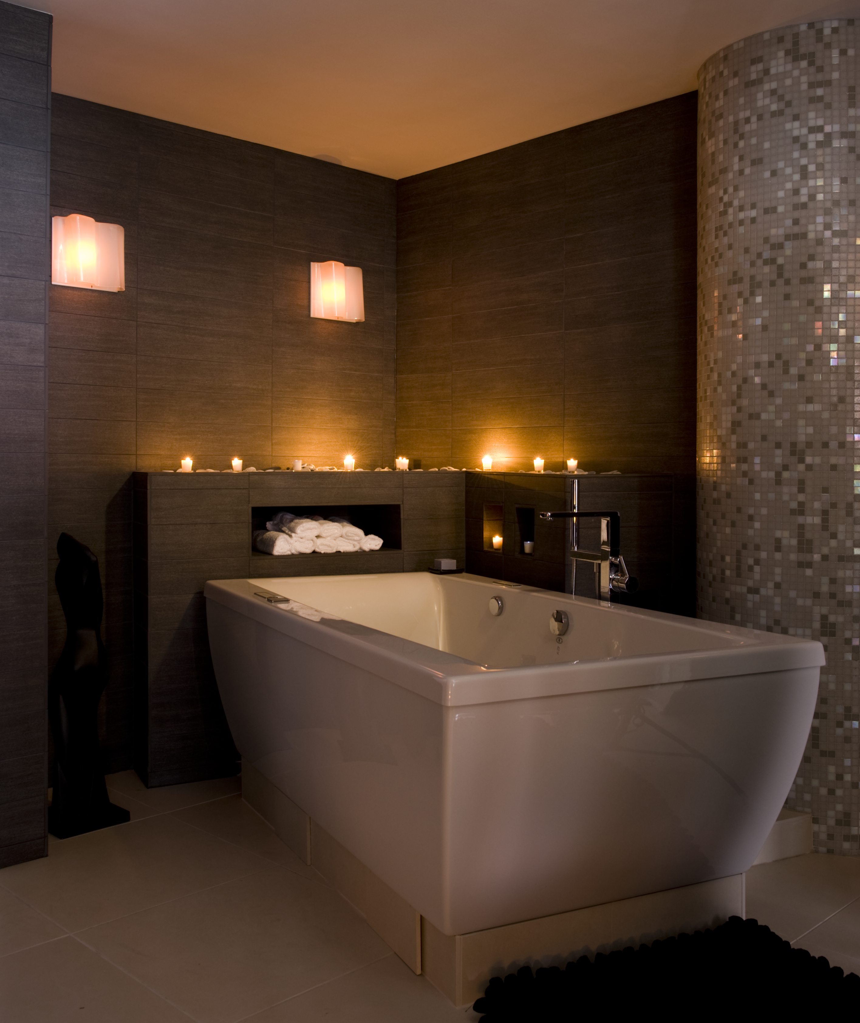 Spa like master bath with floor to ceiling porcelain tiles, double sink, huge shower with steam unit, body jets and rain shower.